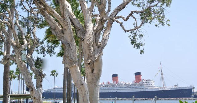 A view of the legendary Queen Mary Luxury Liner from the Shore Village. Long Beach, California