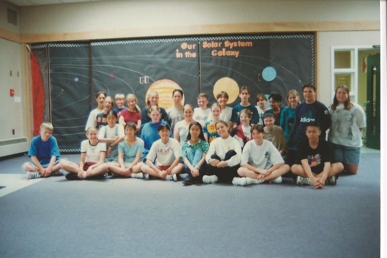 I'm the little blonde in the red shirt, four in from the left in the back.