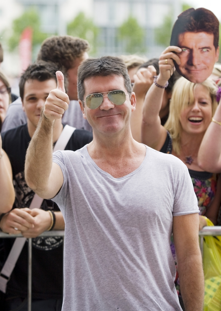 SIMON COWELL IS GOING TO BE A DAD