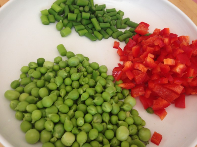 Peas, peppers, and garlic scapes