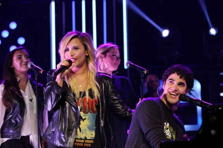 WE DAY TORONTO - Demi Lovato performs on stage for the first time with soon-to-be Glee cast-mate, Darren Criss, at Free The Children's youth empowerment event, We Day, in Toronto on September 20, 2013. Photo Credit: Chris Young/Canadian Press