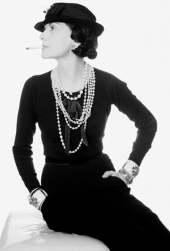 Coco Chanel / photographed by Man Ray.  Wearing the Maltese Cross Cuffs made for her by Duke Fulco di Verdura.