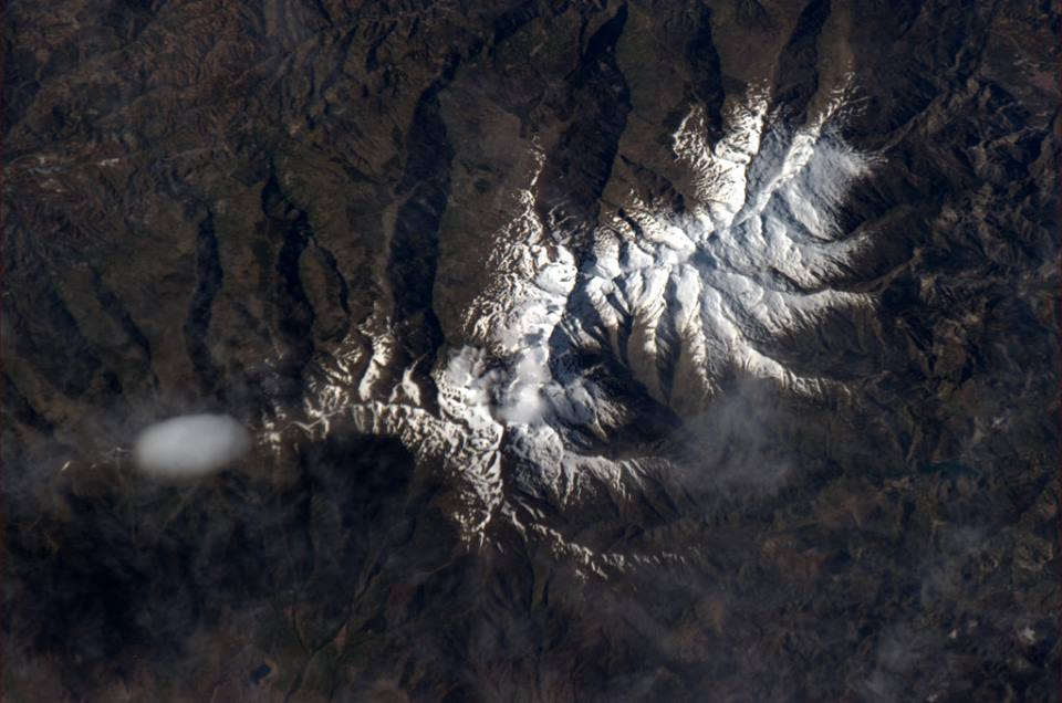 """It surprised me to see that Corsica still had snow in May. And the spider's egg cloud.""  (photo taken from the International Space Station)"