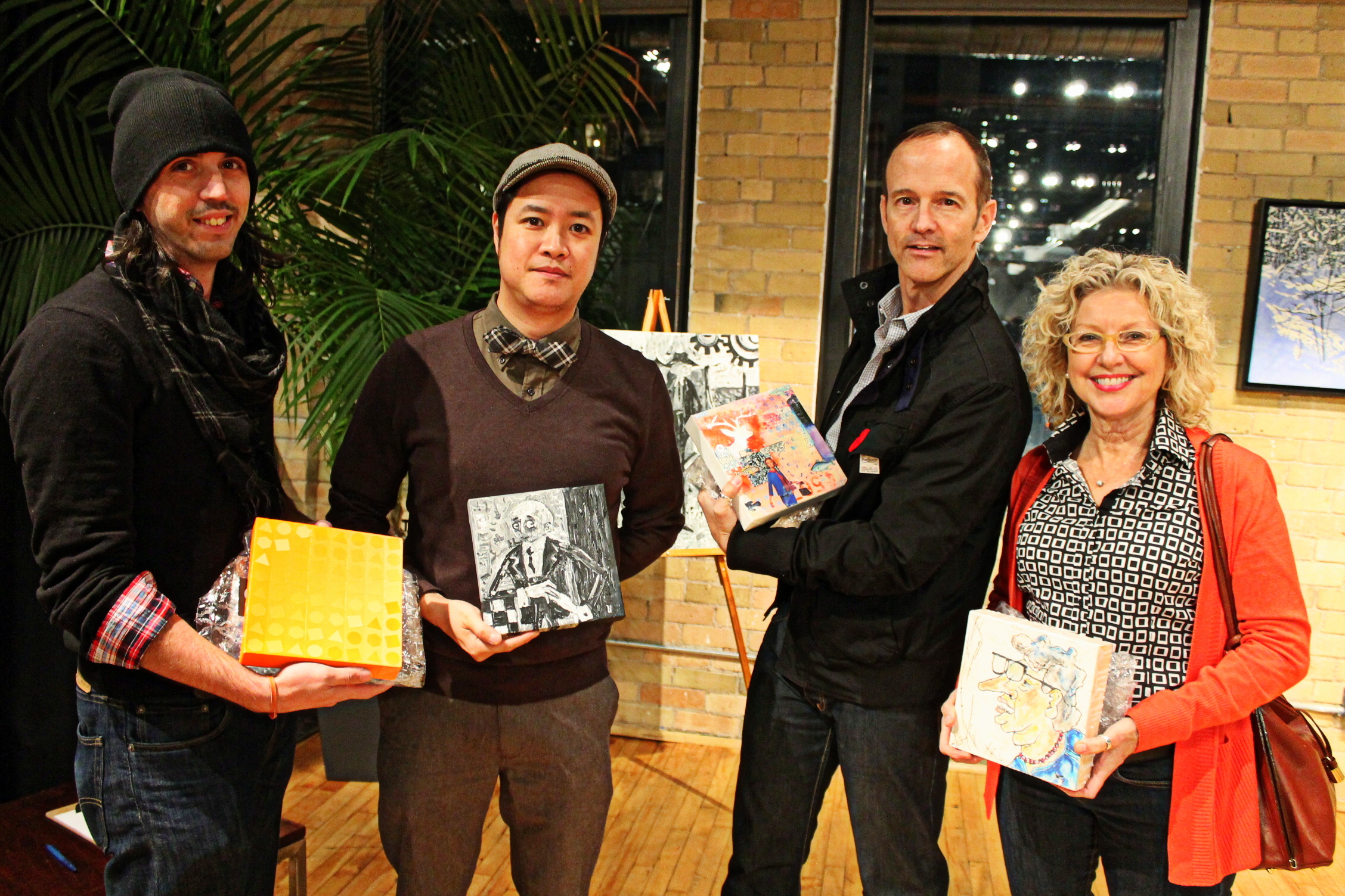 Art lovers at The Spoke Club with their original artworks from Artomb