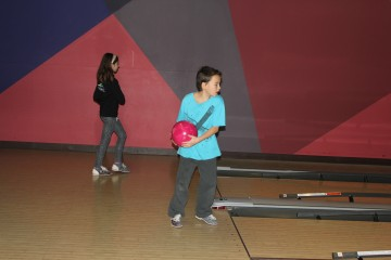Cuyler bowling alongside his oldest friend, who he has been going to school with since preschool.