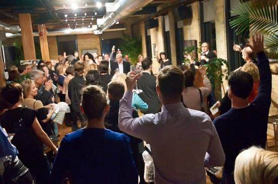 Auctioneer Stephen Ranger hosts the spirited art auction