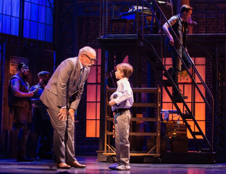 Sandy Winsby (Mr. Price) and Arden Couturier (Young Charlie) in the Canadian Production of Kinky Boots. Photo Credit: Cylla von Tiedemann